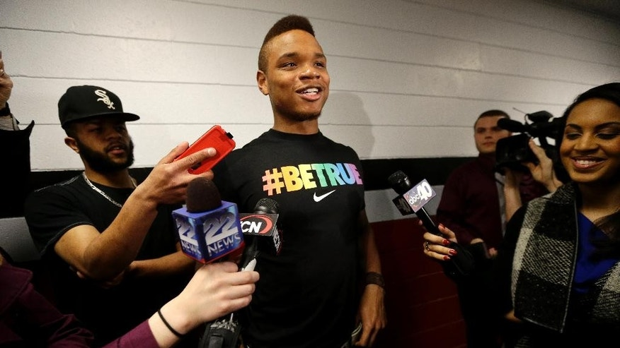 FILE - In this Wednesday, April 9, 2014 file photo, University of Massachusetts basketball guard Derrick Gordon talks with reporters on the school's campus in Amherst, Mass. On April 9, Gordon became the first openly gay player in Division I men's basketball, making the announcement on ESPN and Outsports just two days after the NCAA championship game. (AP Photo/Steven Senne)