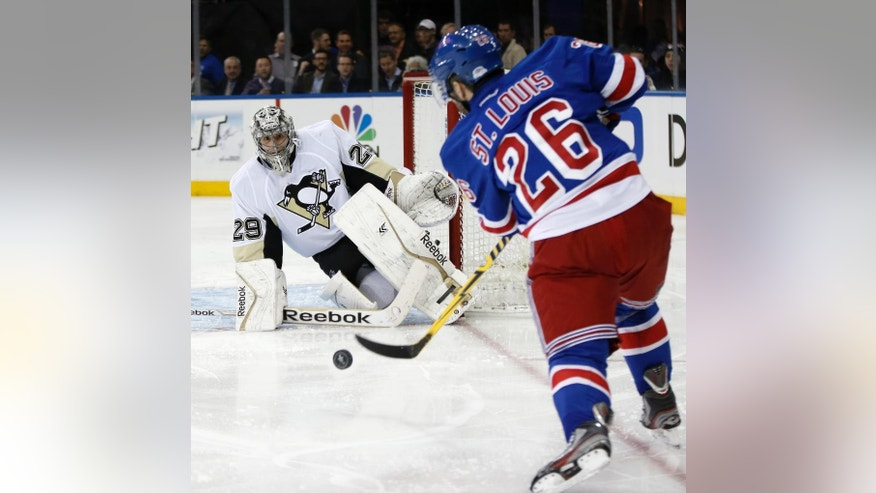 New York Rangers right wing Martin St. Louis (26) takes a shot on Pittsburgh Penguins goalie Marc-Andre Fleury (29) in the second period of their second-round NHL Stanley Cup hockey playoff game at Madison Square Garden in New York, Monday, May 5, 2014.  (AP Photo/Kathy Willens)