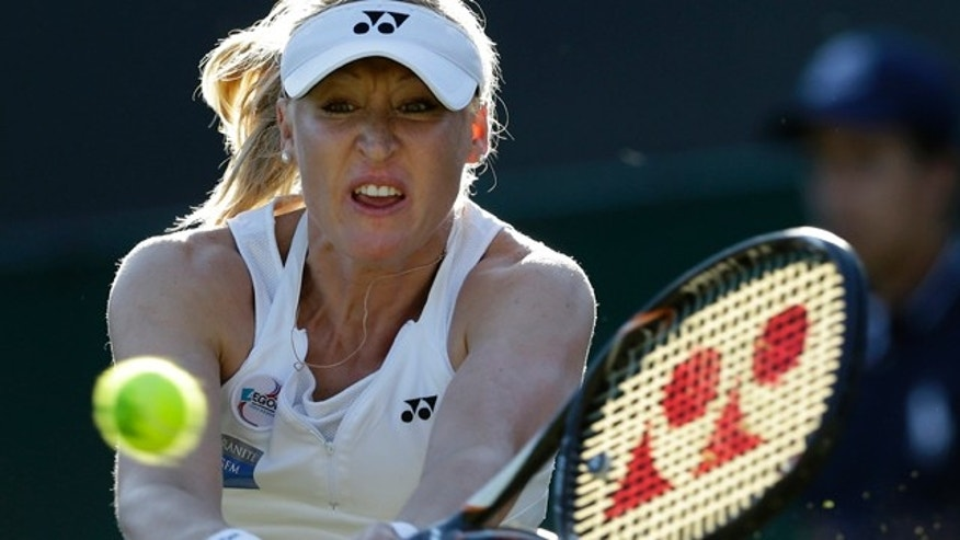 June 28, 2012: Elena Baltacha of Britain returns a shot  to Petra Kvitova of the Czech Republic during a second round women's singles match at the All England Lawn Tennis Championships at Wimbledon, England. The former top-50 professional tennis player who had been fighting liver cancer since retiring from the game, died Sunday at age 30. (AP Photo/Kirsty Wigglesworth, File)