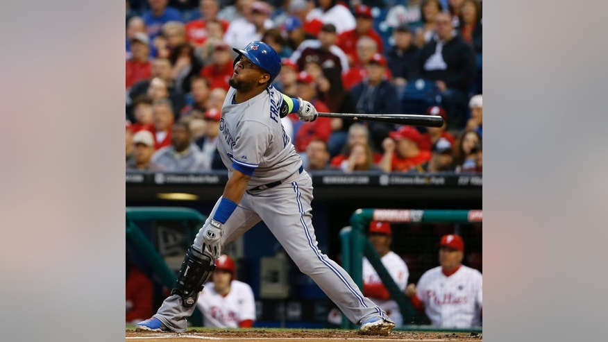 Toronto Blue Jays' Juan Francisco follows through after hitting a run-scoring single during the first inning of an interleague baseball game against the Philadelphia Phillies, Monday, May 5, 2014, in Philadelphia. (AP Photo/Matt Slocum)