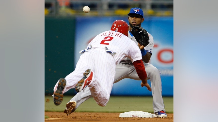 Philadelphia Phillies' Ben Revere, left, tries to steal second base as Toronto Blue Jays shortstop Jose Reyes waits on the throw during the first inning of an interleague baseball game, Monday, May 5, 2014, in Philadelphia. Revere was out on the play. (AP Photo/Matt Slocum)