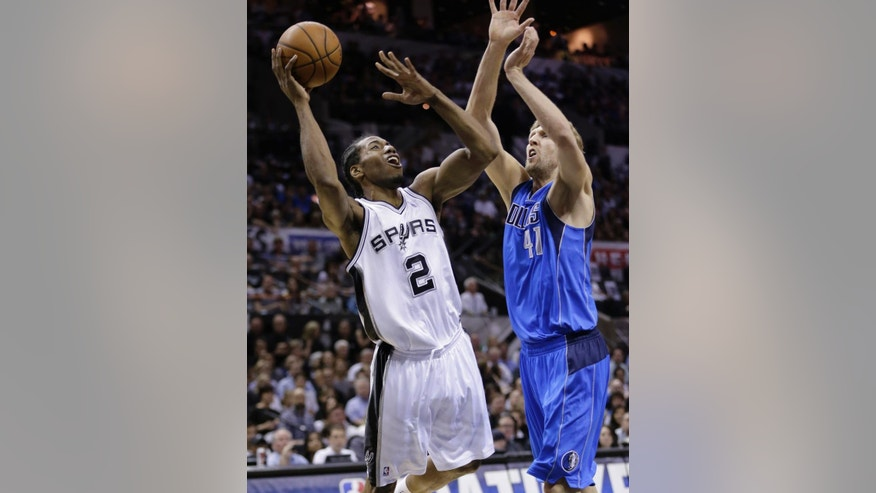 San Antonio Spurs' Kawhi Leonard (2) is pressured by Dallas Mavericks' Dirk Nowitzki (41), of Germany, during the first half of Game 7 of the opening-round NBA basketball playoff series, Sunday, May 4, 2014, in San Antonio. (AP Photo/Eric Gay)