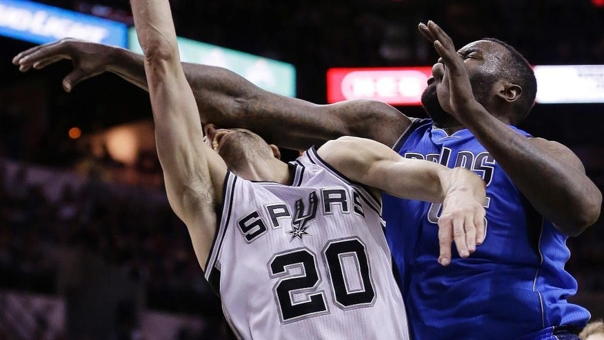 San Antonio Spurs' Manu Ginobili (20), of Argentina, is fouled hard by Dallas Mavericks' DeJuan Blair (45) during the first half of Game 7 of the opening-round NBA basketball playoff series, Sunday, May 4, 2014, in San Antonio. Blair was awarded a flagrant foul on the play.(AP Photo/Eric Gay)