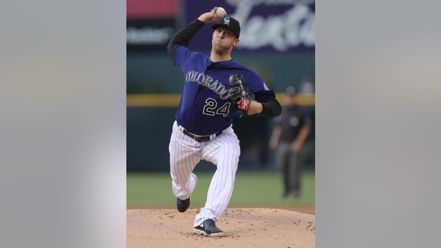 Colorado Rockies starting pitcher Jordan Lyles works against the Texas Rangers in the first inning of an interleague baseball game in Denver on Monday, May 5, 2014. (AP Photo/David Zalubowski)