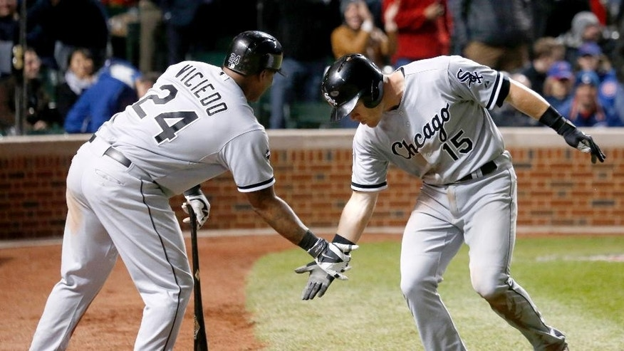 Chicago White Sox's Gordon Beckham, right, celebrates his home run off Chicago Cubs relief pitcher Neil Ramirez with Dayan Viciedo during the eighth inning of an interleague baseball game Tuesday, May 6, 2014, in Chicago. (AP Photo/Charles Rex Arbogast)