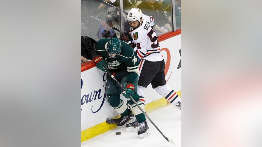 Minnesota Wild defenseman Jonas Brodin (25) and Chicago Blackhawks left wing Brandon Bollig (52) battle for the puck during the first period of Game 3 of an NHL hockey second-round playoff series in St. Paul, Minn., Tuesday, May 6, 2014. (AP Photo/Ann Heisenfelt)
