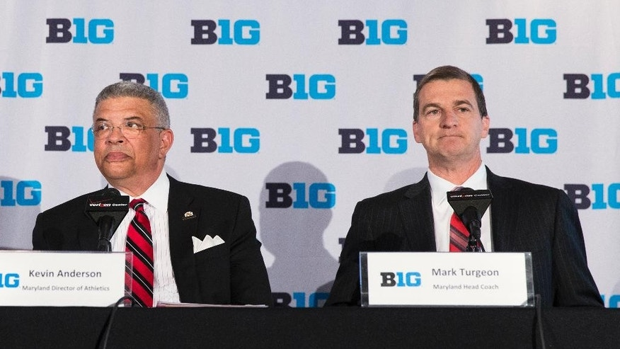 Maryland head basketball coach Mark Turgeon, right, sits with Maryland athletic director Kevin Anderson during a news conference announcing the 2017 Big Ten Conference men's basketball  tournament will be held in Washington, on Tuesday, May 6, 2014, in Washington. Four players have left the Maryland men's basketball program this offseason. (AP Photo/ Evan Vucci)