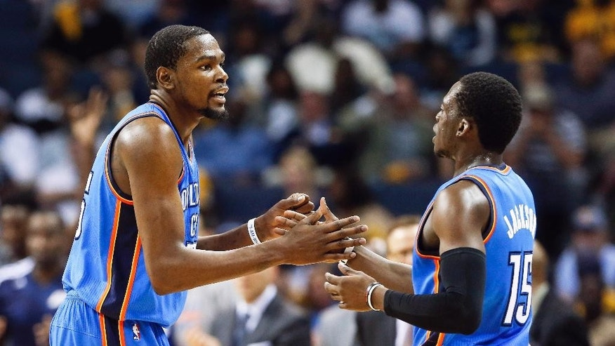 Oklahoma City Thunder forward Kevin Durant, left, and Reggie Jackson (15) celebrate a score against the Memphis Grizzlies in the second half of Game 6 of an opening-round NBA basketball playoff series Thursday, May 1, 2014, in Memphis, Tenn. Oklahoma City won 104-84 to even the series 3-3. (AP Photo/Mark Humphrey)