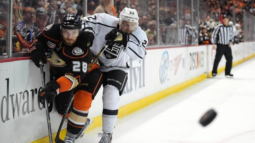 Anaheim Ducks defenseman Mark Fistric, left, and Los Angeles Kings center Trevor Lewis battle for the puck during the second period in Game 2 of an NHL hockey second-round Stanley Cup playoff series, Monday, May 5, 2014, in Anaheim, Calif.  (AP Photo/Mark J. Terrill)