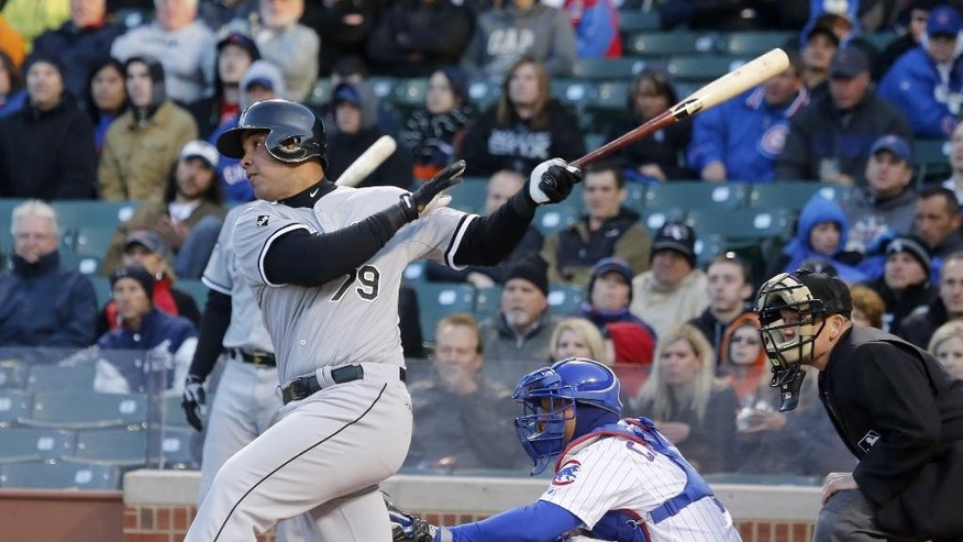 Chicago White Sox's Jose Abreu hits a sacrifice fly off Chicago Cubs starting pitcher Jeff Samardzija, scoring Alejandro De Aza, during the first inning of an interleague baseball game Monday, May 5, 2014, in Chicago. (AP Photo/Charles Rex Arbogast)