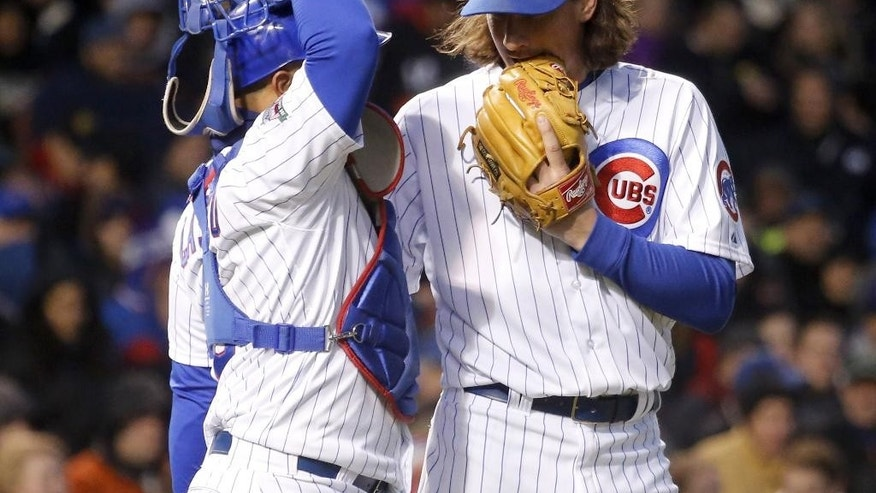Chicago Cubs starting pitcher Jeff Samardzija, right, talks to catcher Welington Castillo during the fourth inning of an interleague baseball game against the Chicago White Sox Monday, May 5, 2014, in Chicago. (AP Photo/Charles Rex Arbogast)