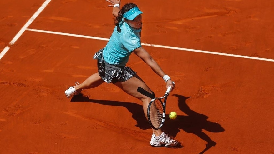 Li Na from China returns the ball during a Madrid Open tennis tournament match against Jie Zheng from China, in Madrid, Spain, Tuesday, May 6, 2014. (AP Photo/Andres Kudacki)