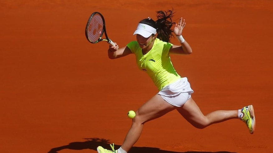 Jie Zheng from China serves during a Madrid Open tennis tournament match against Na Li from China, in Madrid, Spain, Tuesday May 6, 2014. (AP Photo/Andres Kudacki)
