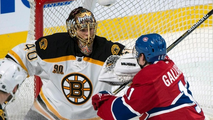 Boston Bruins goalie Tuukka Rask fends off Montreal Canadiens' Brendan Gallagher, right, during second period of Game 3 of an NHL hockey Stanley Cup playoff series, Tuesday, May 6, 2014, in Montreal. (AP Photo/The Canadian Press, Paul Chiasson)