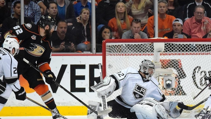 Anaheim Ducks left wing Patrick Maroon, left, scores on Los Angeles Kings goalie Jonathan Quick during the first period in Game 2 of an NHL hockey second-round Stanley Cup playoff series, Monday, May 5, 2014, in Anaheim, Calif.  (AP Photo/Mark J. Terrill)