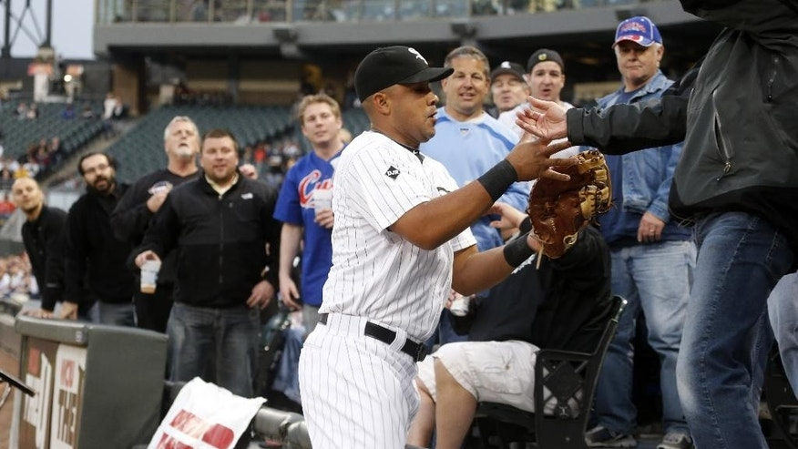 Chicago White Sox first baseman Jose Abreu catches a fly ball off the bat of Chicago Cubs' Darwin Barney in the seats, during the second inning of an interleague baseball game Wednesday, May 7, 2014, in Chicago. (AP Photo/Charles Rex Arbogast)