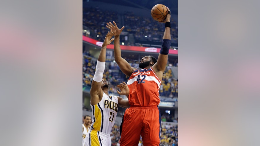 Washington Wizards forward Nene Hilario, right, shoots over Indiana Pacers forward David West during the first half of game 2 of the Eastern Conference semifinal NBA basketball playoff series on Wednesday, May 7, 2014, in Indianapolis. (AP Photo/Darron Cummings)