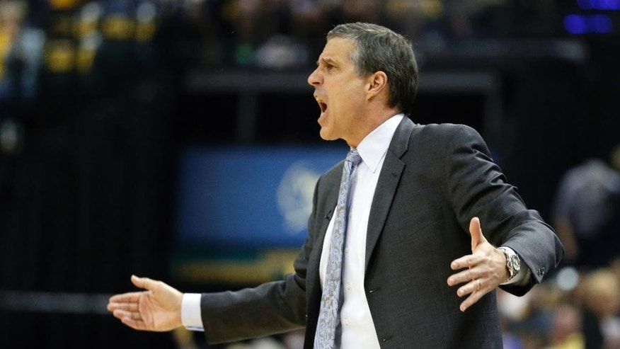Washington Wizards head coach Randy Wittman yells to his team during the first half of game 2 of the Eastern Conference semifinal NBA basketball playoff series against the Indiana Pacers on Wednesday, May 7, 2014, in Indianapolis. (AP Photo/Darron Cummings)