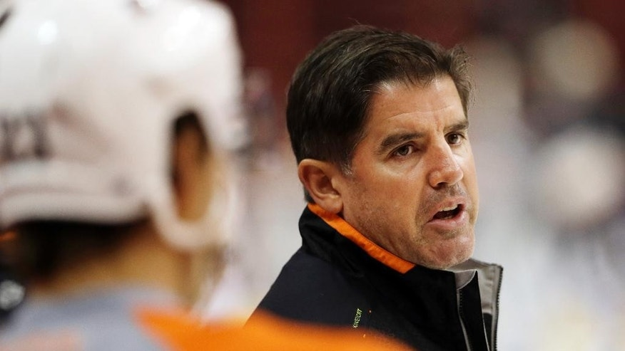 FILE - In this Sept. 12, 2013, file photo, Philadelphia Flyers head coach Peter Laviolette speaks to players during NHL hockey training camp in Philadelphia. The Nashville Predators hired the former Flyers' coach as their new coach on Tuesday, May 6, 2014, making him only the second head coach in the franchise's history. Laviolette, who signed a multi-year contract, will take over in Nashville once he finishes coaching the United States at the 2014 World Championship. (AP Photo/Matt Rourke, File)