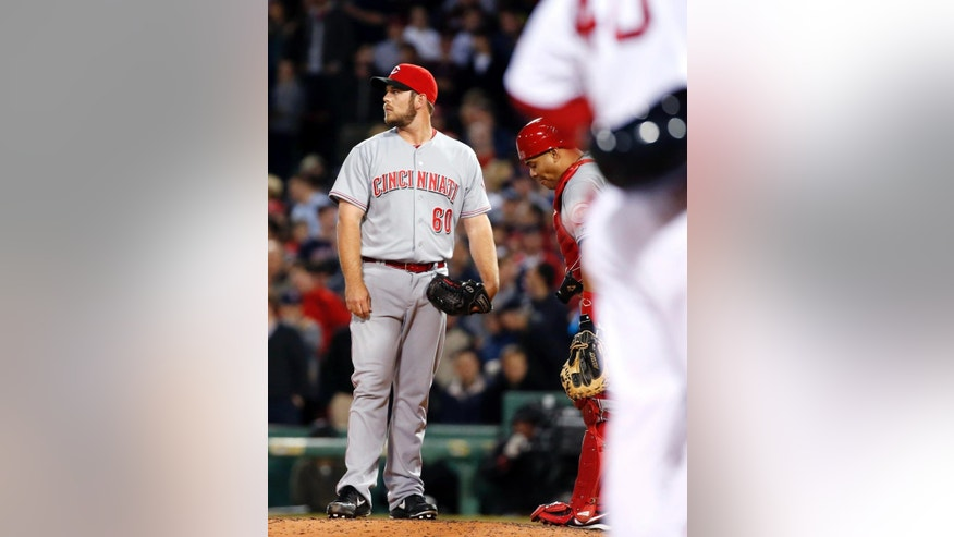 Cincinnati Reds relief pitcher J.J. Hoover (60) stands on the mound with catcher Brayan Pena after giving up the go-ahead run to the Boston Red Sox in the eighth inning of a baseball game at Fenway Park in Boston, Wednesday, May 7, 2014. Boston Red Sox's A.J. Pierzynski, far right, stands on third base. The Red Sox won 4-3. (AP Photo/Elise Amendola)