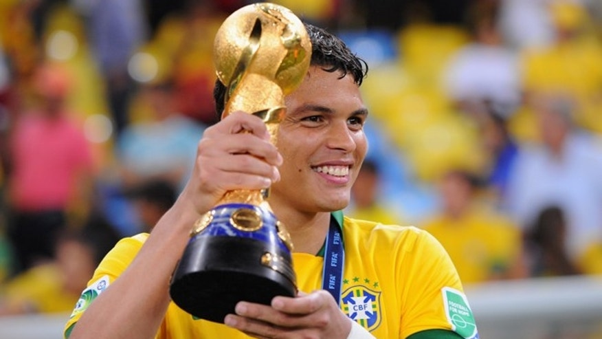 Thiago Silva holds the Confederations Cup on June 30, 2013 in Rio de Janeiro, Brazil.