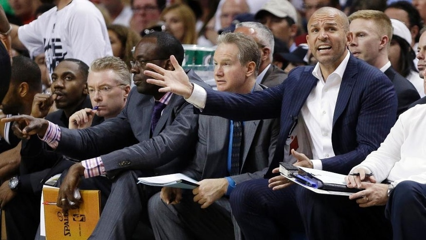 Brooklyn Nets head coach Jason Kidd, second from right, gestures in the first half of Game 1 in an NBA basketball Eastern Conference semifinal playoff series against the Miami Heat, Tuesday, May 6, 2014, in Miami. (AP Photo/Lynne Sladky)