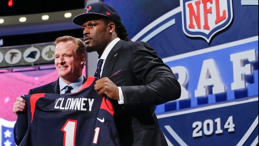 May 8, 2014: South Carolina defensive end Jadeveon Clowney holds up the jersey for the Houston Texans' first pick of the first round of the 2014 NFL Draft with NFL commissioner Roger Goddell.