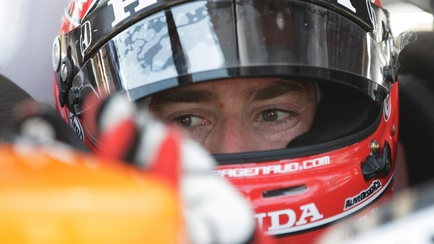 Simon Pagenaud, of France, adjust a mirror on his car during a practice session for the inaugural Grand Prix of Indianapolis IndyCar auto race at the Indianapolis Motor Speedway in Indianapolis, Thursday, May 8, 2014. (AP Photo/Darron Cummings)