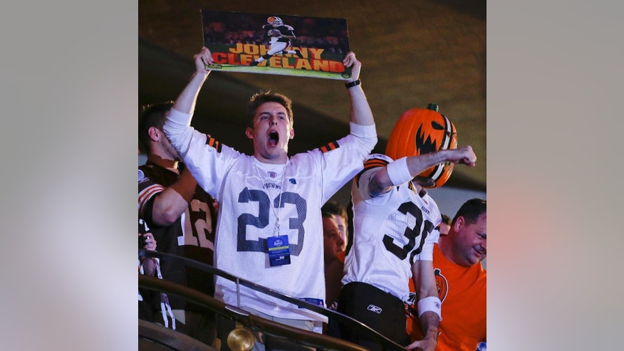 A Cleveland Browns fan reacts after the Browns selected Texas A&M quarterback Johnny Manziel as the 22nd pick in the first round of the 2014 NFL Draft, Thursday, May 8, 2014, in New York. (AP Photo/Frank Franklin II)