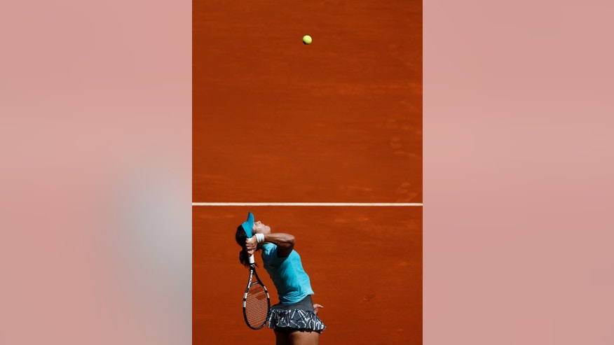 Na Li from China serves the ball during a Madrid Open tennis tournament match against Sloane Stephens from the U.S. in Madrid, Spain, Thursday, May 8, 2014 . (AP Photo/Daniel Ochoa de Olza)