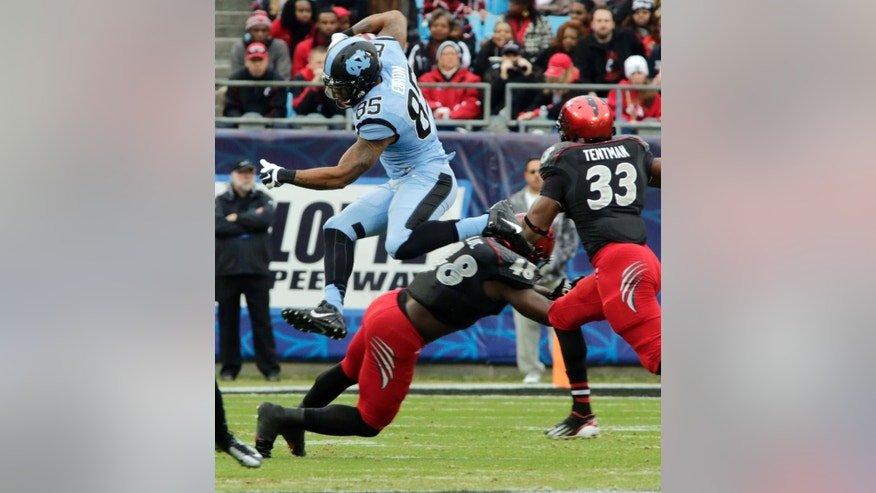 FILE - In this Dec. 28, 2013, file photo, North Carolina's Eric Ebron (85) leaps over Cincinnati's Jeff Luc (48) during the first half of the Belk Bowl NCAA college football game in Charlotte, N.C. Ebron had a breakout junior season with 62 catches for 973 yards, breaking ACC record for yards by tight end held by Vernon Davis at Maryland. He is a top prospect in the upcoming NFL draft. (AP Photo/Nell Redmond, File)