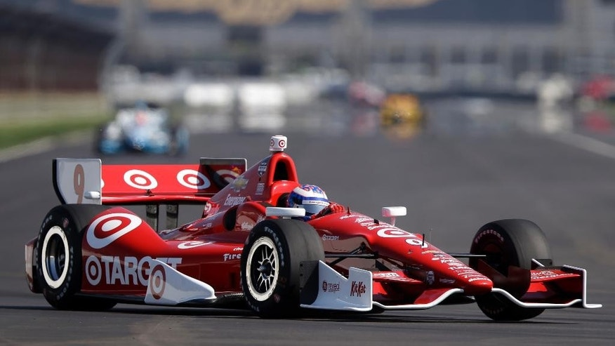 Scott Dixon, of New Zealand, drives through the turn 7 during practice for the inaugural Grand Prix of Indianapolis IndyCar auto race at the Indianapolis Motor Speedway in Indianapolis, Thursday, May 8, 2014. (AP Photo/Michael Conroy)