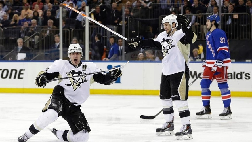 Pittsburgh Penguins' Evgeni Malkin (71), of Russia, celebrates a goal as Chris Kunitz and New York Rangers' Brian Boyle, right, skate near during the first period of a second-round NHL Stanley Cup hockey playoff series Wednesday, May 7, 2014, in New York. (AP Photo/Frank Franklin II)