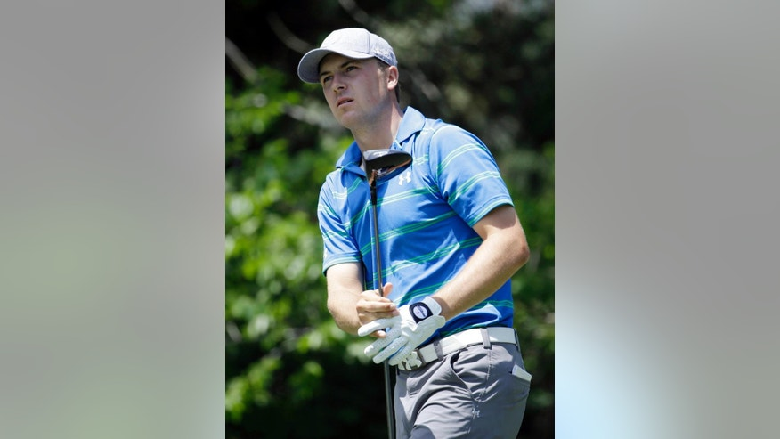 Jordan Spieth watches his shot from the fifth tee during the first round of The Players championship golf tournament at TPC Sawgrass, Thursday, May 8, 2014, in Ponte Vedra Beach, Fla. (AP Photo/Lynne Sladky)
