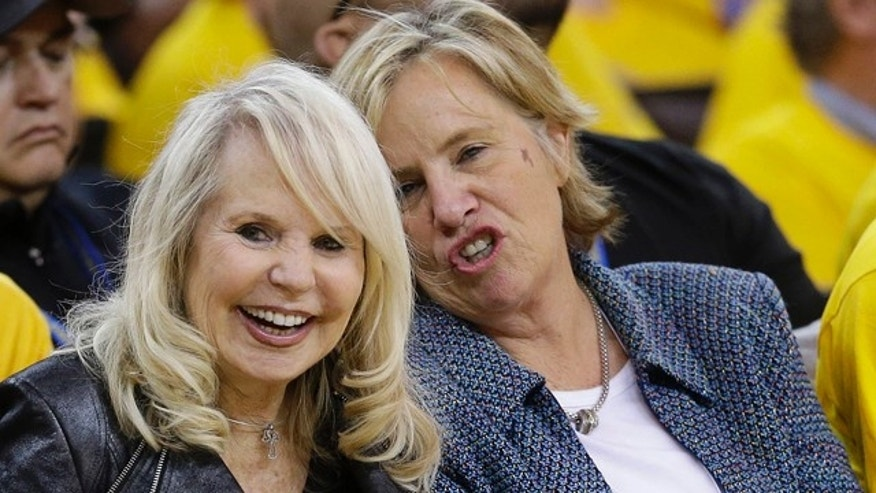 April 27, 2014: Shelly Sterling, left, wife of Los Angeles Clippers owner Donald Sterling, watches from a courtside seat during the second half of Game 4 of an opening-round NBA basketball playoff series between the Clippers and Golden State Warriors. (AP Photo/Marcio Jose Sanchez)