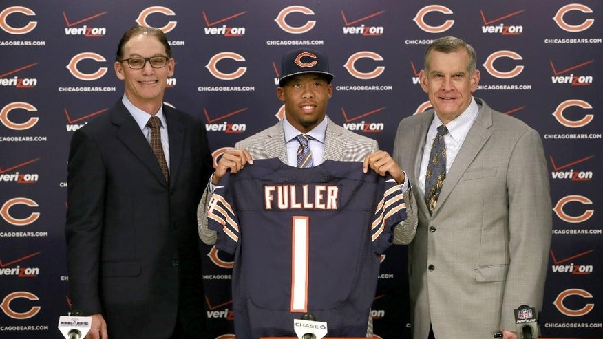 Chicago Bears head coach Marc Trestman, left, and  general manager Phil Emery, right,  introduce the team's first-round draft pick, Virginia Tech cornerback Kyle Fuller, during an NFL football news conference Friday, May 9, 2014, in Lake Forest, Ill. (AP Photo/Charles Rex Arbogast)