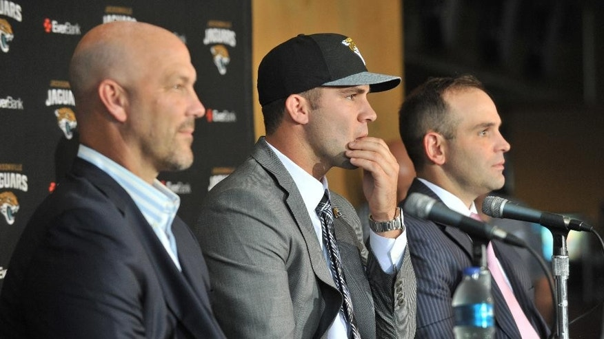 Jacksonville Jaguars first round draft pick Blake Bortles, center, talks to the media with head coach Gus Bradley, left, and general manager Dave Caldwell during an NFL football news conference Friday, May 9, 2014 at EverBank Field in Jacksonville, Florida.  (AP Photo/The Florida Times-Union, Will Dickey)