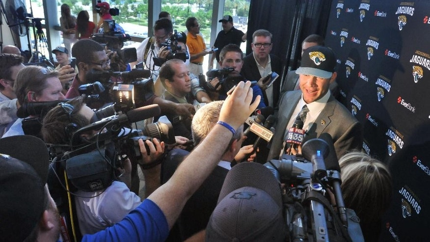 Jacksonville Jaguars first round draft pick Blake Bortles is surrounded by the media during an NFL football news conference Friday, May 9, 2014, at EverBank Field in Jacksonville, Fla.  (AP Photo/The Florida Times-Union, Will Dickey)