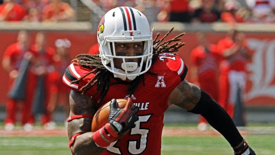 FILE - In this Sept. 7, 2013, file photo, Louisville's Calvin Pryor turns and runs after picking off a pass against Eastern Kentucky in an NCAA college football game in Louisville, Ky. Pryor was selected in the first round, 18th overall, by the New York Jets in the NFL draft on Thursday, May 8, 2014.  (AP Photo/Garry Jones, File)