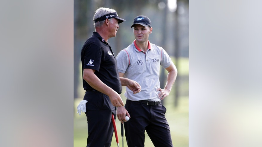 Martin Kaymer of Germany, right, speaks with Darren Clarke of Northern Ireland, while waiting their turn on the sixth green, during the second round of The Players championship golf tournament at TPC Sawgrass, Friday, May 9, 2014 in Ponte Vedra Beach, Fla. (AP Photo/Lynne Sladky)