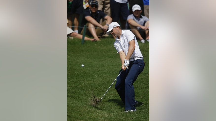 Jordan Spieth hits from the rough on the ninth hole during the second round of The Players championship golf tournament at TPC Sawgrass, Friday, May 9, 2014, in Ponte Vedra Beach, Fla. (AP Photo/Gerald Herbert)