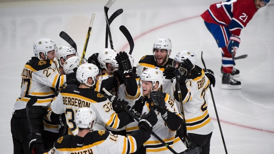 Montreal Canadiens captain Brian Gionta watches members of the Boston Bruins celebrate the game-winning goal by Matt Fraser during the first overtime period in Game 4 in the second round of the NHL Stanley Cup playoffs Thursday, May 8, 2014, in Montreal. (AP Photo/The Canadian Press, Paul Chiasson)
