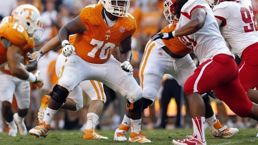 FILE - In this Aug. 31, 2014, file photo, Tennessee's Ja'Wuan James (70) blocks during the first quarter of an NCAA college football game against Austin Peay in Knoxville, Tenn. James was selected in the first round, 19th overall, by the Miami Dolphins in the NFL draft on Thursday, May 8, 2014. (AP Photo/Wade Payne, File)