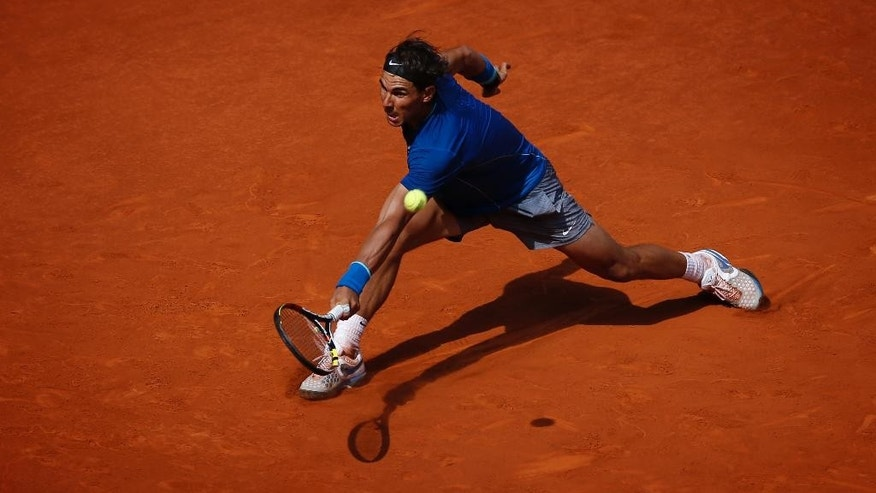 Rafael Nadal from Spain returns the ball during a Madrid Open tennis tournament match against Jarkko Nieminen, from Finland, in Madrid, Spain, Thursday, May 8, 2014. (AP Photo/Daniel Ochoa de Olza)