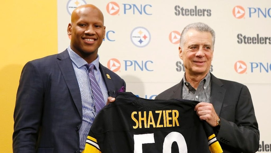 Pittsburgh Steelers President Arthur J. Rooney II, right, poses with a team jersey beside Steelers' first-round draft selection, 15th overall, linebacker Ryan Shazier from Ohio State at the headquarters of the NFL football team in Pittsburgh on Friday, May 9, 2014. (AP Photo/Keith Srakocic)