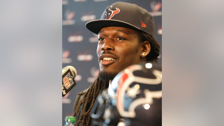 Houston Texans No. 1 overall NFL draft pick defensive end Jadeveon Clowney meets the media during an introductory NFL football news conference Friday, May 9, 2014, in Houston. (AP Photo/Pat Sullivan)