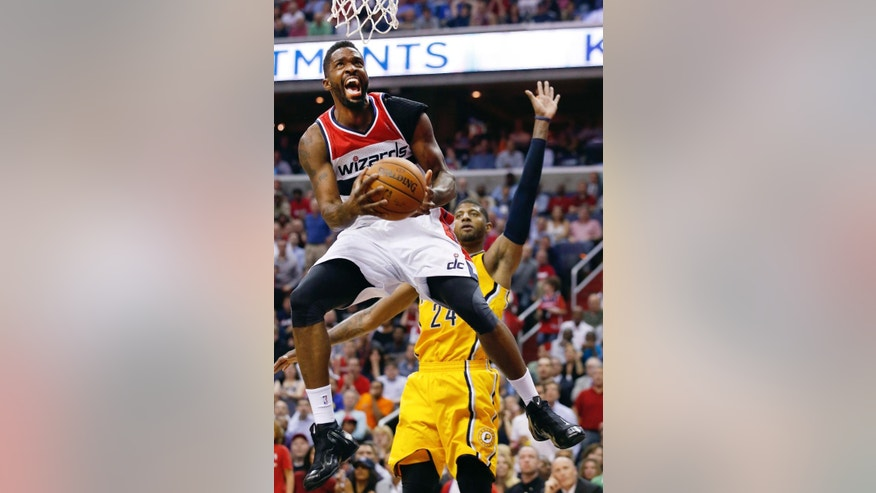 Washington Wizards forward Martell Webster shoots past Indiana Pacers forward Paul George (24) during the first half of Game 3 of an Eastern Conference semifinal NBA basketball playoff game in Washington, Friday, May 9, 2014. (AP Photo/Alex Brandon)