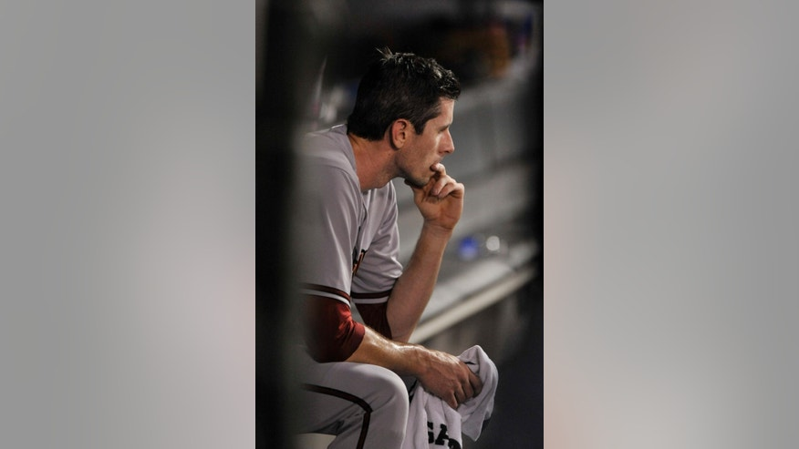 Arizona Diamondbacks starting pitcher Brandon McCarthy looks on in the dugout after being pulled during the fourth inning of a baseball game against the Chicago White Sox in Chicago, Friday, May 9, 2014. (AP Photo/Paul Beaty)