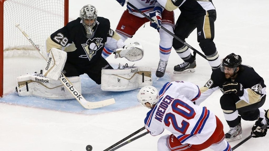 New York Rangers' Chris Kreider (20) cannot get a shot past Pittsburgh Penguins goalie Marc-Andre Fleury (29) and Brian Gibbons (49) in the first period of Game 5 of a second-round NHL playoff hockey series in Pittsburgh, Friday, May 9, 2014. (AP Photo/Gene J. Puskar)