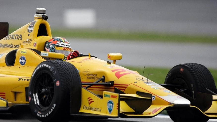 Ryan Hunter-Reay drives through a turn during practice for the inaugural Grand Prix of Indianapolis IndyCar auto race at the Indianapolis Motor Speedway in Indianapolis, Friday, May 9, 2014. (AP Photo/Darron Cummings)